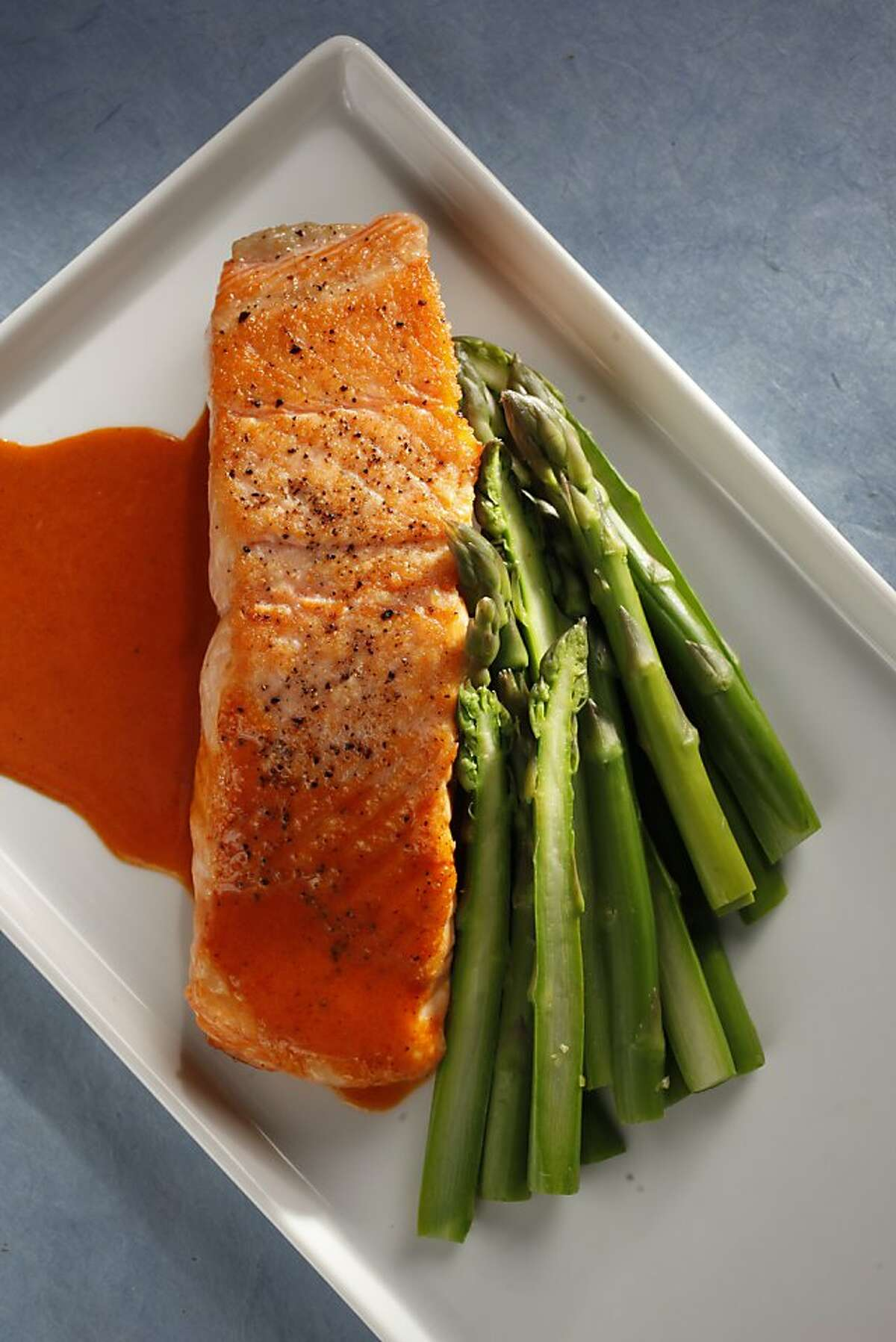 Pan-seared salmon fillet with smokey chili-lime butter sauce as seen in San Francisco, California, on Wednesday April 20, 2011. Food styled by Sophie Brickman.