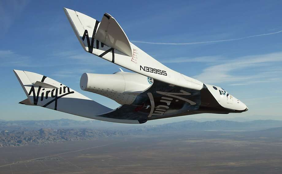 In this photo released by Virgin Galactic, the Virgin Galactic SpaceShipTwo, or VSS Enterprise,  glides toward the earth on its first test flight after release from the mothership, WhiteKnight2, also known as VMS Eve, over the Mojave, Calif., area early Sunday, Oct. 10, 2010. SpaceShipTwo is undergoing rigorous testing before it can carry tourists to space. In the latest test, SpaceShipTwo did not fire its rocket engine to climb to space. The craft was piloted by engineer and test pilot Pete Siebold from Scaled Composites. (AP Photo/Clay Observatory for Virgina Galactic, Mark Greenberg) NO SALES Photo: Mark Greenberg, AP