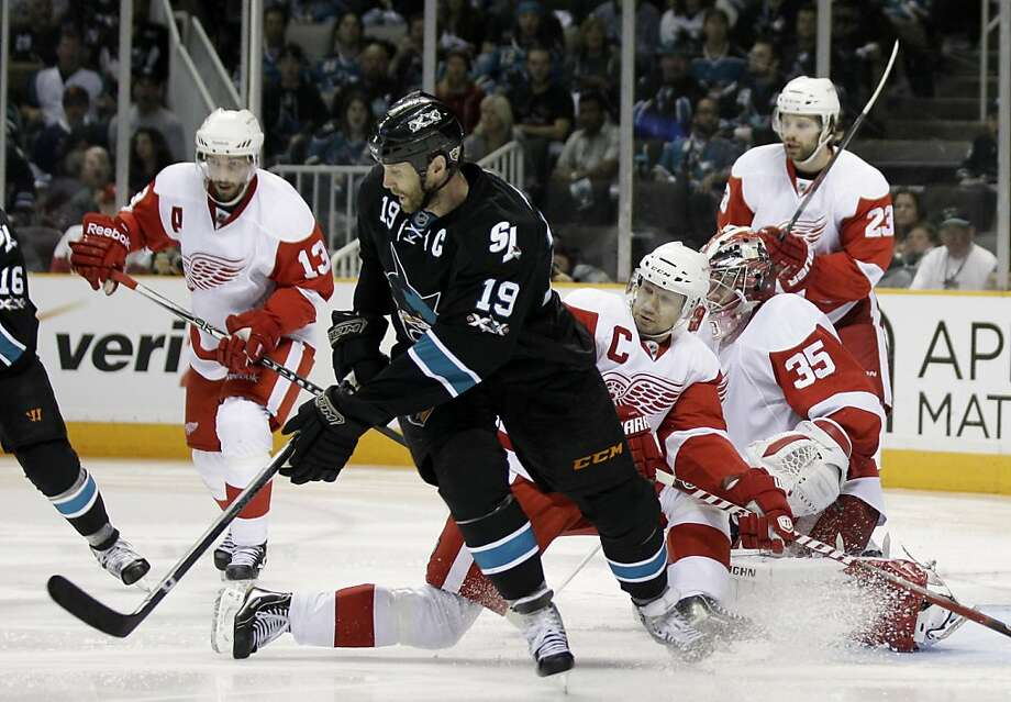 San Jose Sharks center Joe Thornton (19) is defended by Detroit Red Wings defenseman Nicklas Lidstrom, of Sweden, center, during the third period in Game 2 of an NHL Western Conference semifinal Stanley Cup playoff hockey series game in San Jose, Calif.,Sunday, May 1, 2011. San Jose won 2-1. Photo: Marcio Jose Sanchez, AP