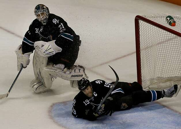 In the final seconds, the Sharks' Joe Thornton slides into the goal next to goalie Antti Niemi. San Jose beat the Detroit Red Wings in game two of the Western Conference semifinals at HP Pavilion on Sunday. Photo: Brant Ward, The Chronicle
