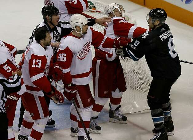 The Sharks' Joe Pavelski (right) gets into a fight with Red Wings players near their goal in the second period of game two of the Western Conference semifinals at HP Pavilion on Sunday. Photo: Brant Ward, The Chronicle