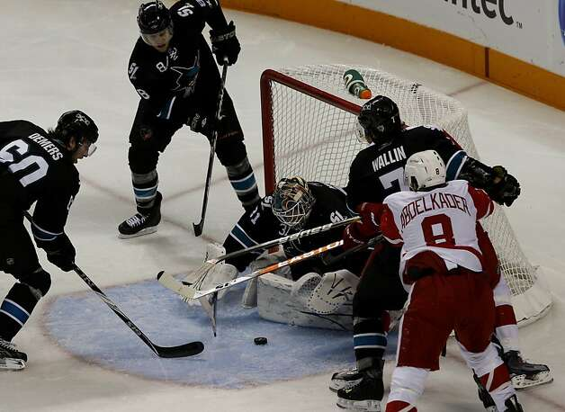 Sharks goalie Antti Niemi manages to save a goal in the third period against the Detroit Red Wings in game two of the Western Conference semifinals at HP Pavilion on Sunday. Photo: Brant Ward, The Chronicle