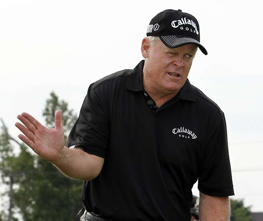 FILE - This Aug. 10, 2010, file photo shows Johnny Miller explaining a golf swing at a golf clinic during the Champions for Change Golf Challenge at Harbor Shores Golf Club in Benton Harbor, Mich. You can count on Johnny Miller to be impartial at the Ryder Cup as an analyst for NBC Sports. American or European, he can get under anyone's skin.  (AP Photo/John Smierciak, File) Photo: John Smierciak, AP
