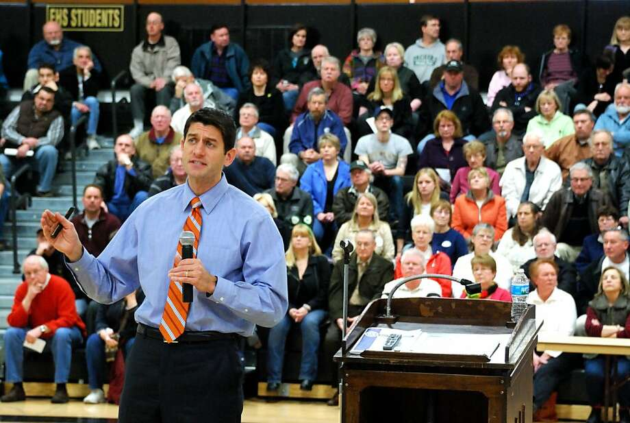 TO GO WITH AFP STORY BY MIRA OBERMAN Republican House Budget Committee Chairman Paul Ryan outlines his budget plans at a town hall meeting at a high school in Franklin, Wisconsin on April 28, 21011. Angry voters jeered and booed as the architect of the Republican budget plan tried to explain why raising taxes on the rich wouldn't help the United States deal with its deficit problems. Photo: Mira Oberman, AFP/Getty Images