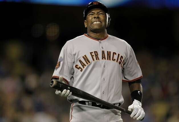 The Giants Miguel Tejada reacts after he hit a pop up in foul territory  which was caught the end the eighth inning with the bases loaded, as the San Francisco Giants went on to lose to the Los Angeles Dodgers 7-5, on Sunday Apr. 3, 2011, at Dodger Stadium, in Los Angeles, Ca. Photo: Michael Macor, The Chronicle