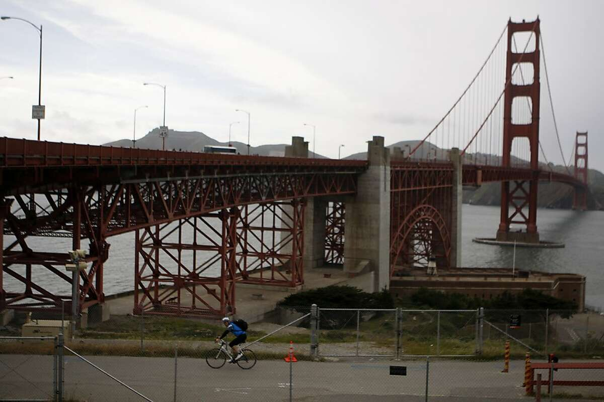A bicyclist pedals underneath the Golden Gate Bridge to get to the West side which is bicycles-only on weekdays after 3:30 pm, on Friday April 22, 2011. The Golden Gate Bridge conducted a safety study that recommends restrictions on bicycling across the bridge, most notably a 10 mph speed limits.