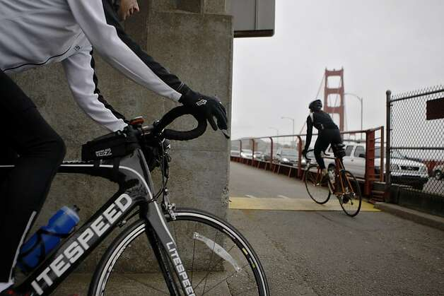 Two bicyclists pedal onto the West side of the Golden Gate Bridge on Friday, April 22, 2011. The west side is bicycles-only after 3:30 pm on weekdays. The Golden Gate Bridge conducted a safety study that recommends restrictions on bicycling across the bridge, most notably a 10 mph speed limits. Photo: Anna Vignet, The Chronicle