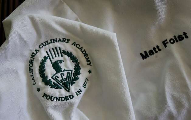 Matt Foist kept his jacket from his year at the California Culinary Academy. Matt Foist of Mountain View, Calif., is among a group of people who have sued the California Culinary Academy.  They claim they were mislead about the money they could make as trained chefs.  Foist is in debt over $40,000. Photo: Brant Ward, The Chronicle