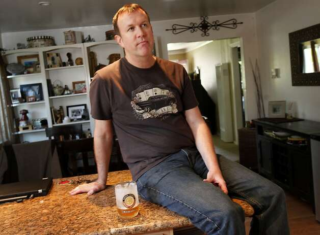 Matt Foist sits in the kitchen of his home in Mountain View Wednesday April 27, 2011. Matt Foist of Mountain View, Calif., is among a group of people who have sued the California Culinary Academy.  They claim they were mislead about the money they could make as trained chefs.  Foist is in debt over $40,000. Photo: Brant Ward, The Chronicle