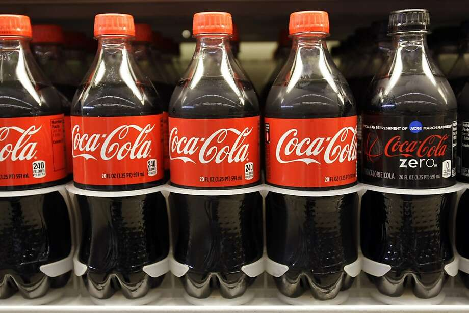 Bottles of Coca-Cola are displayed for sale at a grocery store in Palo Alto, Calif., Monday, April 25, 2011. Photo: Paul Sakuma, AP