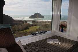 Surfsong's window seat invites curling up for a good read or enjoying view of the sea.