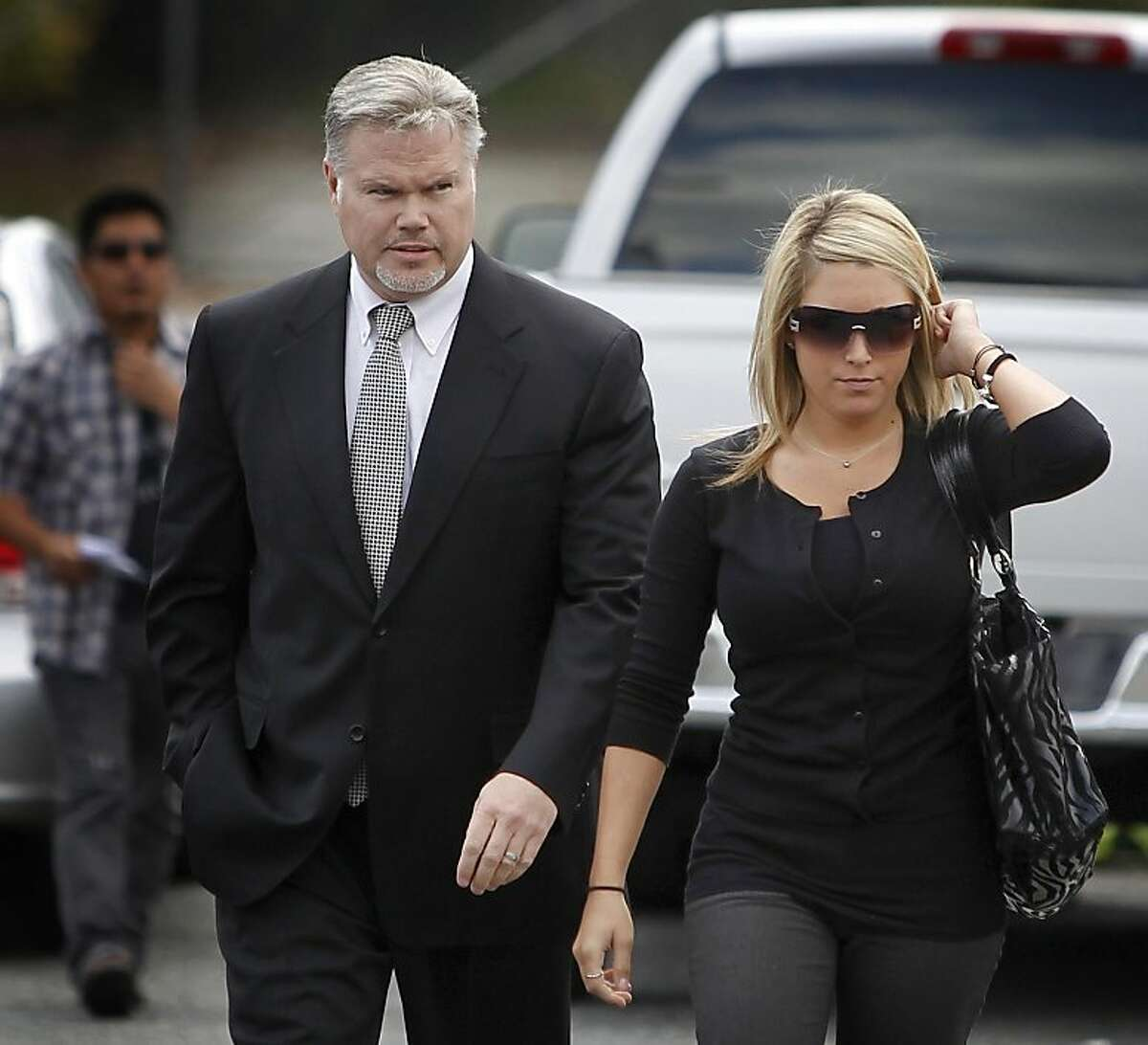 Former private investigator Christopher Butler arrives for a hearing at Contra Costa County Superior Court with two unidentified women in Walnut Creek, Calif. on Thursday, April 21, 2011. Prosecutors allege that Butler resold illegal drugs that were stoleFormer private investigator Christopher Butler arrives for a hearing at Contra Costa County Superior Court with two unidentified women in Walnut Creek, Calif. on Thursday, April 21, 2011. Prosecutors allege that Butler resold illegal drugs that were stolen from evidence lockers by Norman Wielsch.