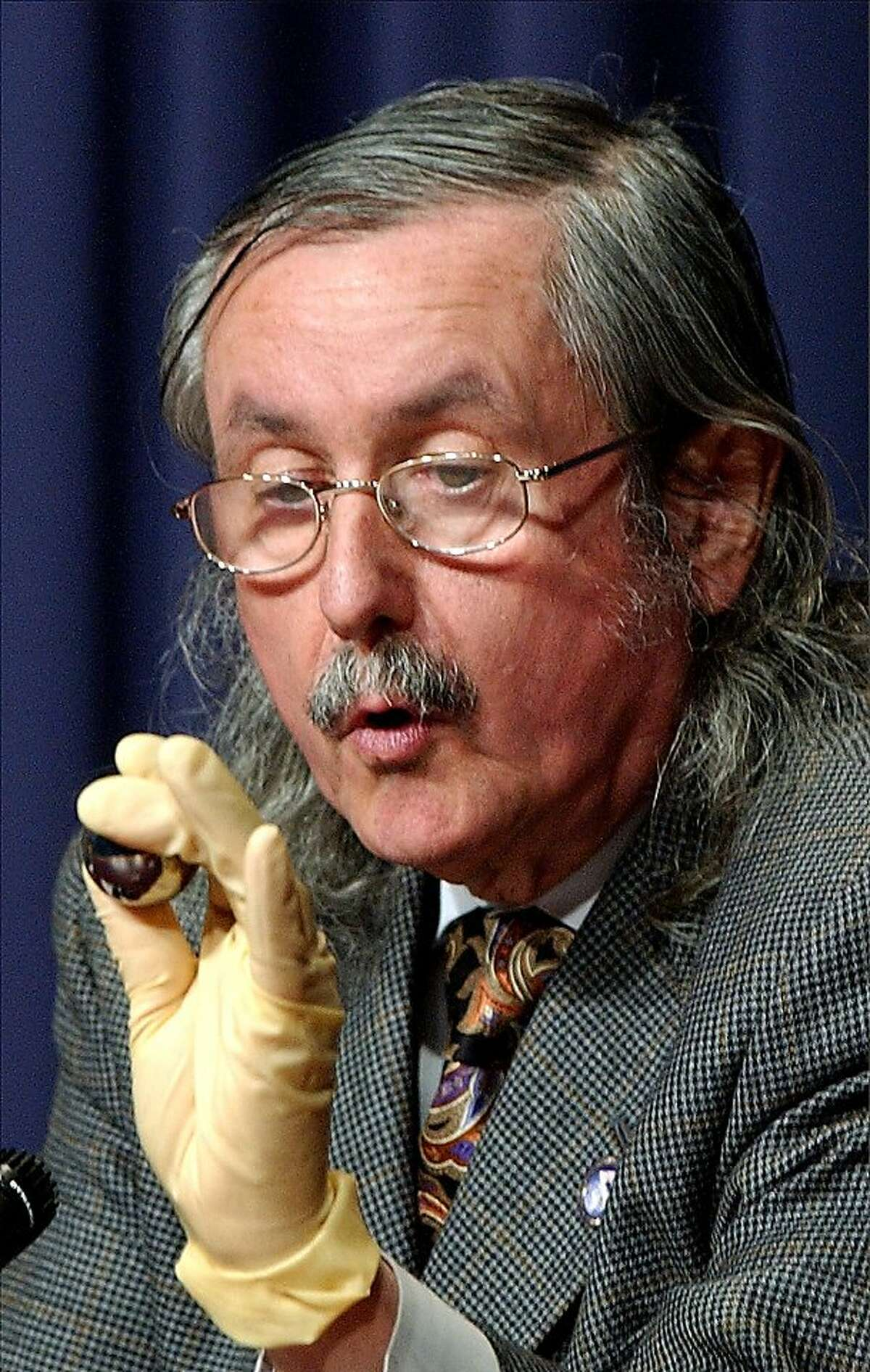 Francis Everitt of Stanford University holds a gyroscope during a briefing in Washington, Friday, April 2, 2004.