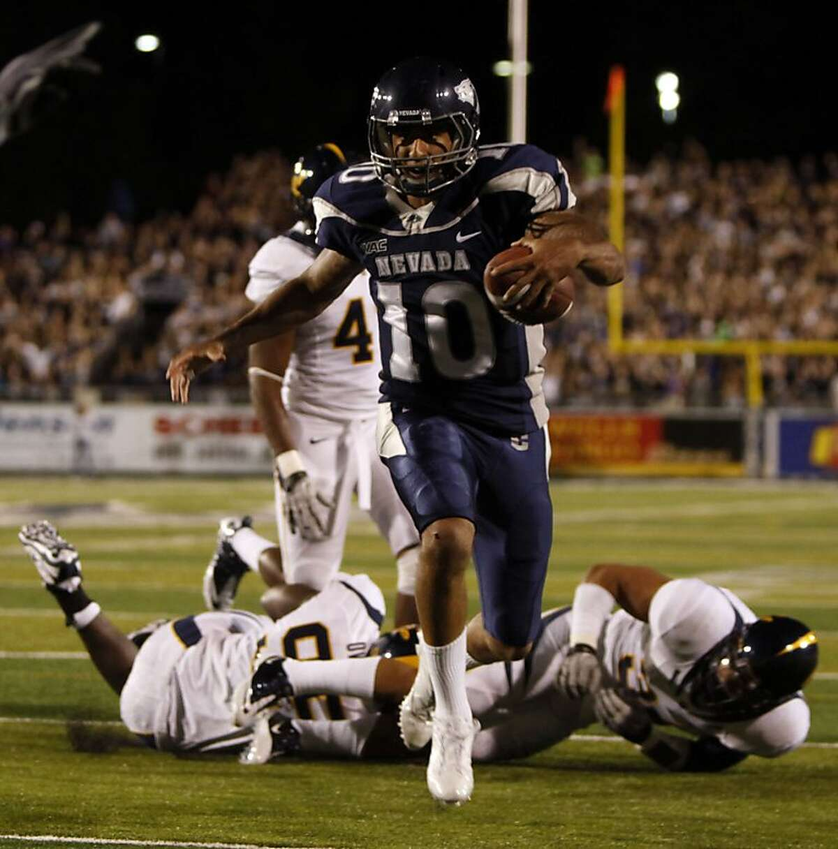 Nevada's Colin Kaepernick runs into the end zone for his second touchdown in the first half of their NCAA college football game Friday, Sept. 17, 2010,against California in Reno, Nevada. Nevada leads at the half 24-14