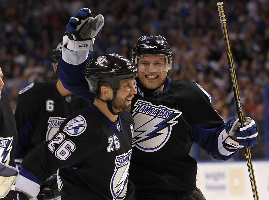 TAMPA, FL - MAY 04: Martin St. Louis #26 and Sean Bergenheim #10 of the Tampa Bay Lightning celebrate their 5-3 victory over the Washington Capitals in Game Four of the Eastern Conference Semifinals during the 2011 NHL Stanley Cup Playoffs at the St PeteTimes Forum on May 4, 2011 in Tampa, Florida. The Lightning defeated the Capitals 5-3 and swept the series four games to none. Photo: Bruce Bennett, Getty Images