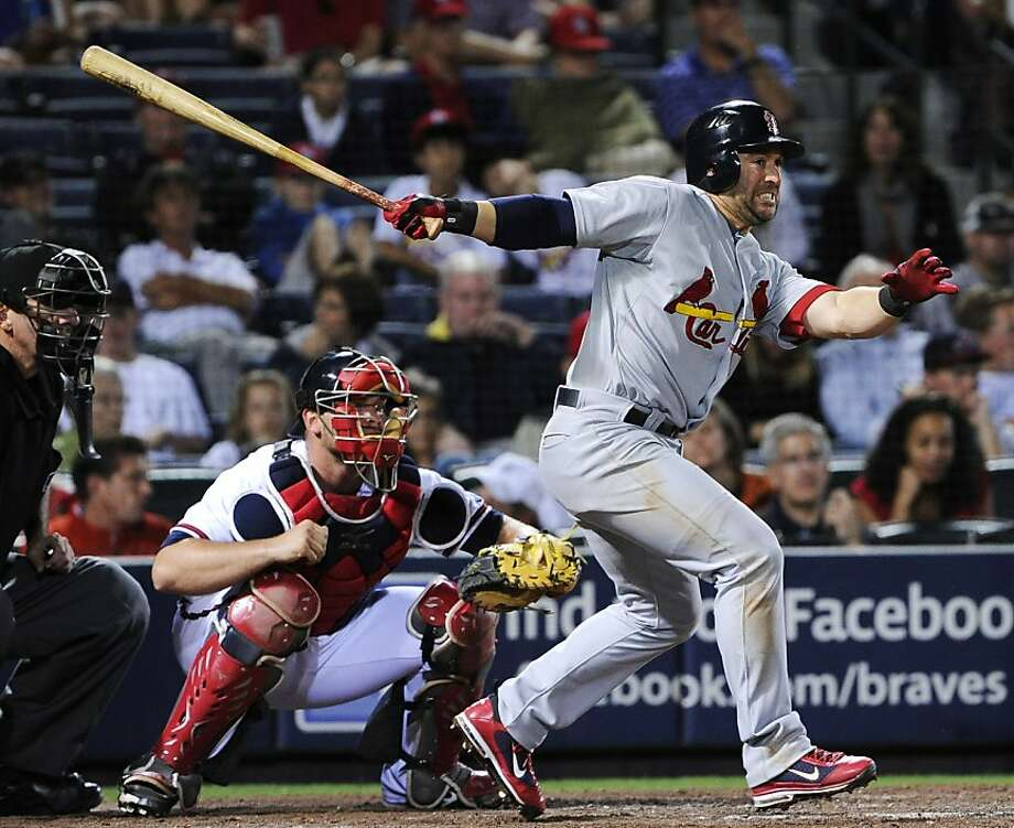 St. Louis Cardinals' Nick Punto connects to hit two runs in to go ahead against the Atlanta Braves during the 11th inning of an MLB baseball game, Friday, April 29, 2011, in Atlanta. St. Louis won 5-3. Photo: John Amis, AP