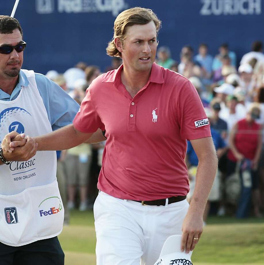 Webb Simpson shakes hands with his caddie after losing in an playoff at the Zurich Classic golf tournament in Avondale, La. on Sunday, May 1, 2011.  Simpson and Bubba Watson were tied after regulation and Watson defeated Simpson on the second hole of extra play. Both were tied at 273 15-under par in regulation. Photo: Bill Haber, AP