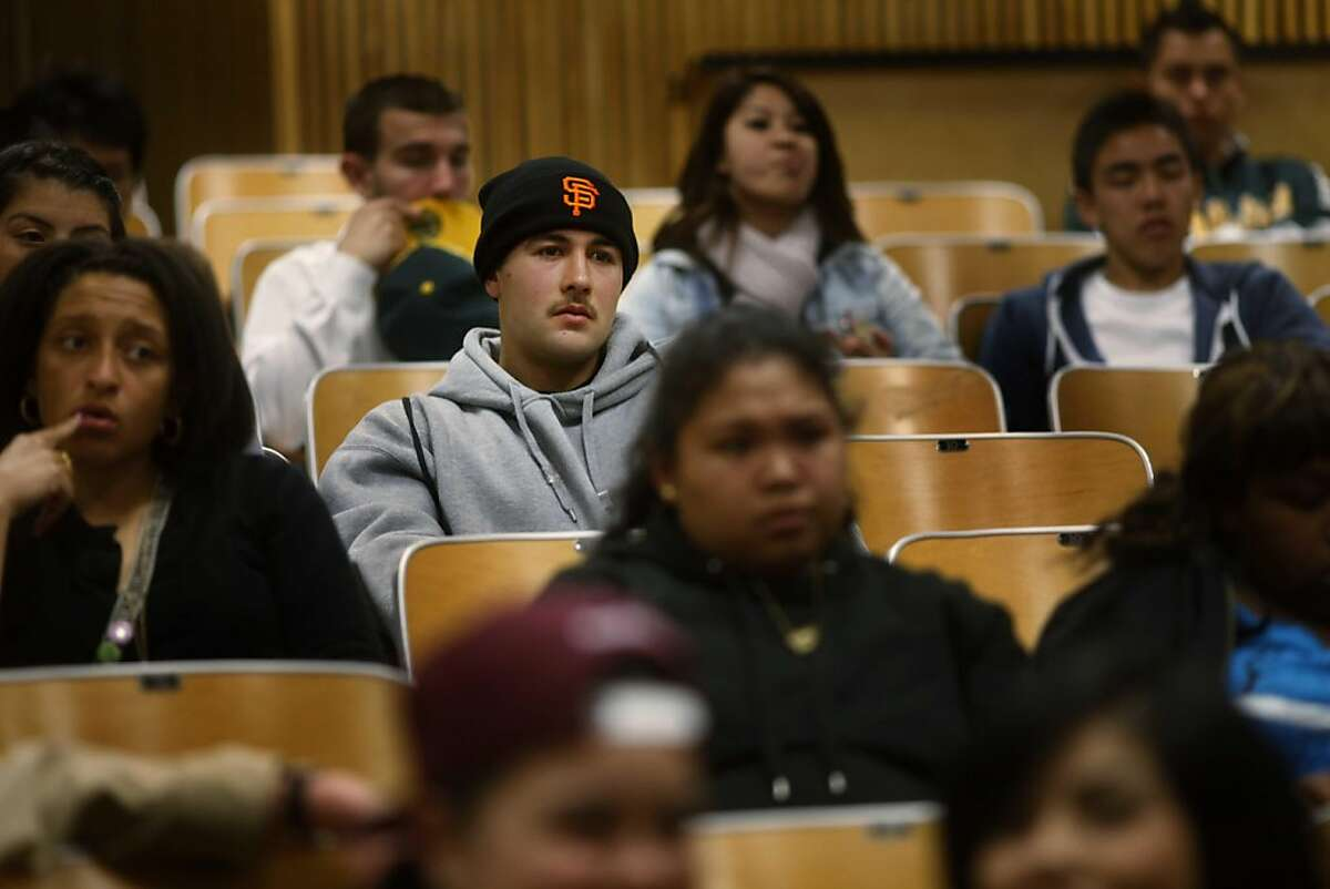 Fernando Gonzalez, 18, of Phillip and Sala Burton Academic High School, listens to a college counselor give an orientation presentation at San Francisco City College during and event called