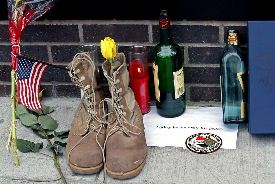 In the aftermath of the death of Osama bin Laden, the architect of the Sept. 11 attacks, a tribute including a pair of military boots, is left outside Firehouse 343 at the World Trade Center construction site on Tuesday, May 3, 2011, in New York. Photo: Bebeto Matthews, AP