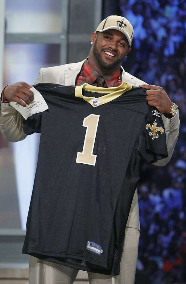 California defensive end Cameron Jordan poses for photographs after he was selected as the 24th overall pick by the New Orleans Saints in the first round of the NFL football draft at Radio City Music Hall on Thursday, April 28, 2011, in New York. Photo: Jason DeCrow, AP