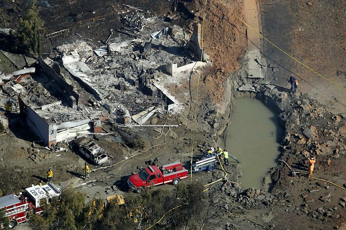 Emergency crews search destroyed homes near a large crater in a neighborhood in San Bruno, Calif. on Friday, Sept. 10, 2010 after a massive natural gas pipeline explosion Thursday night.