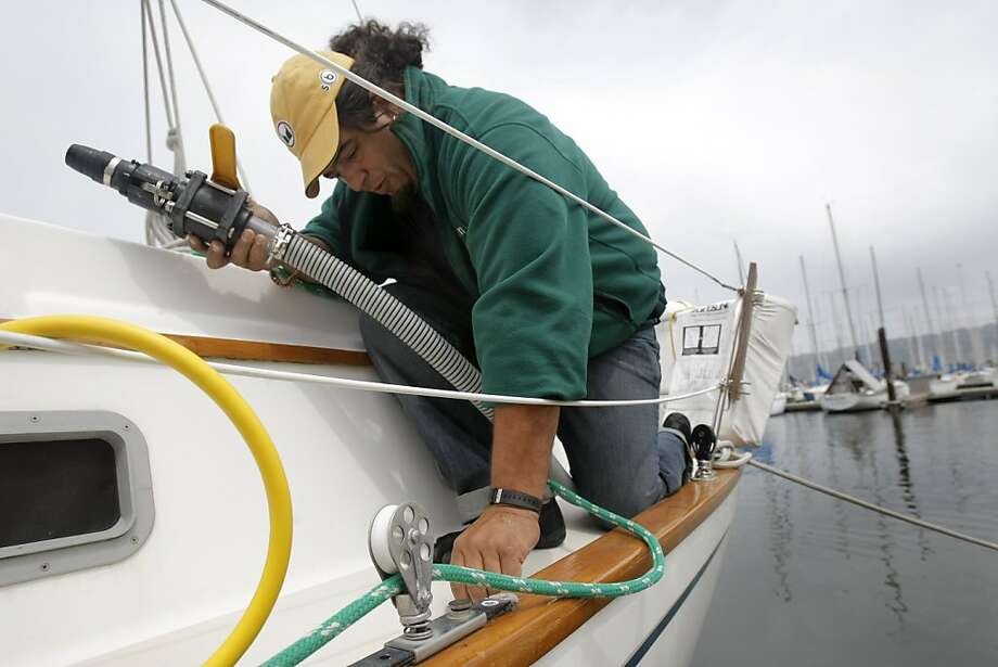 Dan Augustine, owner and operator of BayGreen, replaces a pump cap after pumping out a boat's wastewater holding tank in Berkeley Marina in Berkeley, Calif., on Friday, April 22, 2011. Photo: Thomas Levinson, The Chronicle