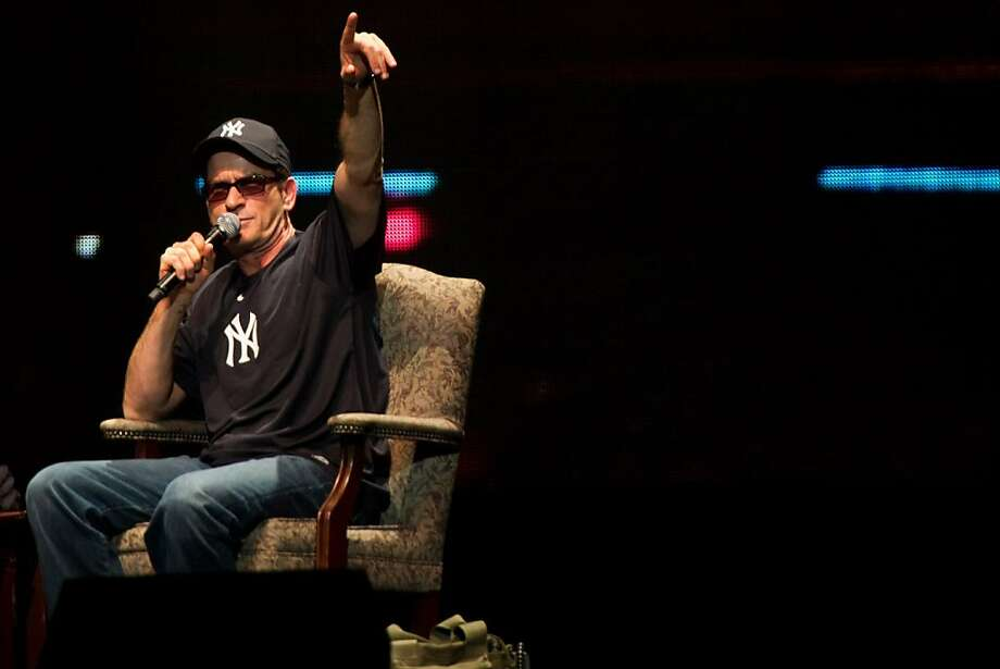 """Charlie Sheen appears onstage at his """"Violent Torpedo of Truth"""" show at Radio City Music Hall in New York, Friday, April 8, 2011. Photo: Charles Sykes, ASSOCIATED PRESS"""