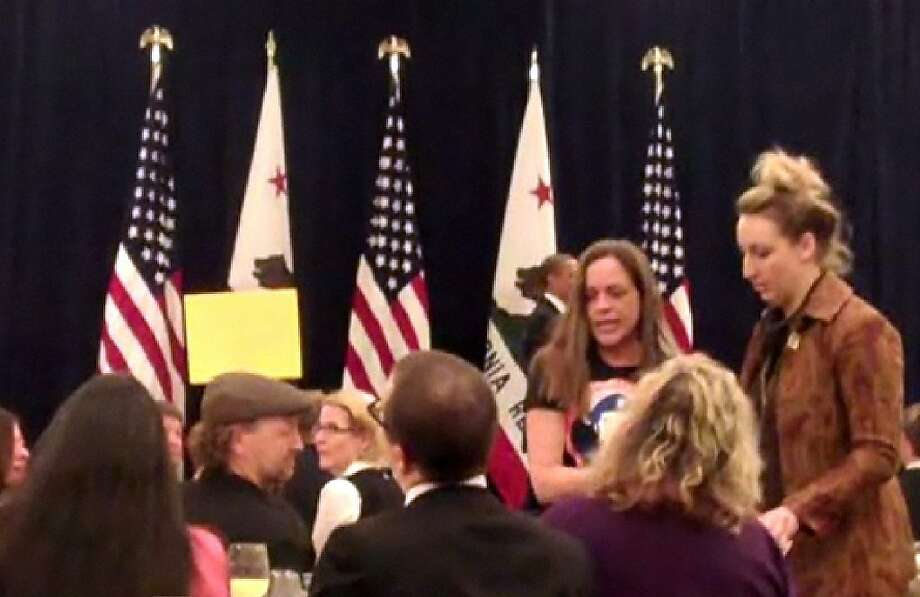 Protesters disrupt President Barack Obama's breakfast fundraiser at the St. Regis Hotel in San Francisco, Calif., on Thursday, April 21, 2011. Photo: Carla Marinucci, The Chronicle