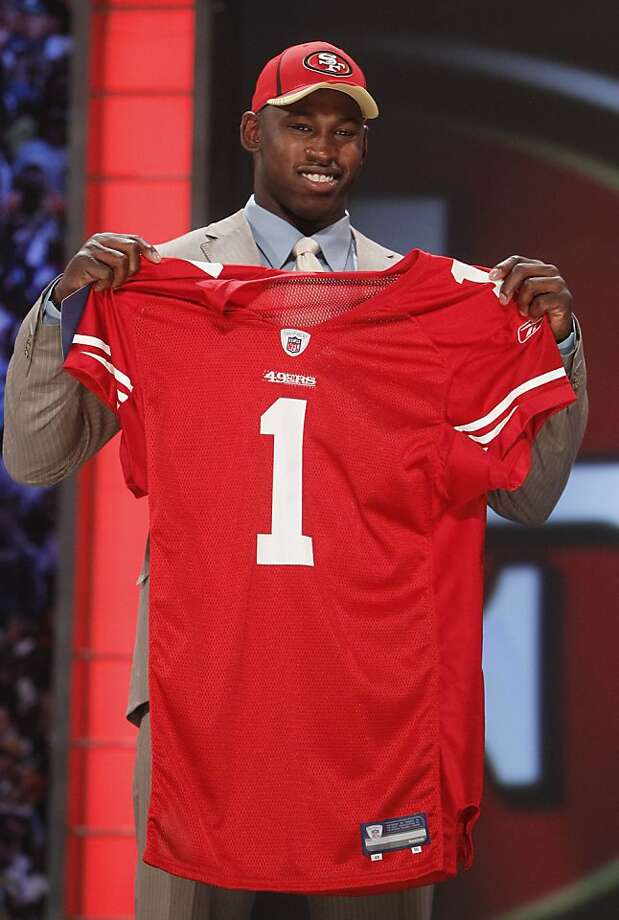 Missouri defensive end Aldon Smith holds up a jersey after he was selected as the seventh overall pick by the San Francisco 49ers in the first round of the NFL football draft at Radio City Music Hall Thursday, April 28, 2011, in New York. Photo: Jason DeCrow, AP