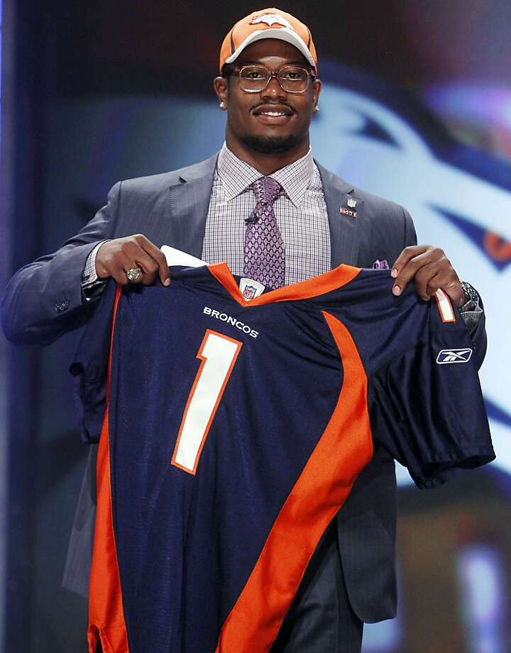 Texas A&M linebacker Von Miller holds up a jersey after he was selected as the second overall pick by the Denver Broncos in the first round of the NFL football draft at Radio City Music Hall Thursday, April 28, 2011, in New York. Photo: Jason DeCrow, AP