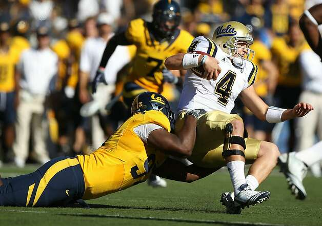 BERKELEY, CA - OCTOBER 09:  Kevin Price #4 of the UCLA Bruins is tackled by Cameron Jordan #97 of the California Golden Bears at California Memorial Stadium on October 9, 2010 in Berkeley, California. Photo: Jed Jacobsohn, Getty Images