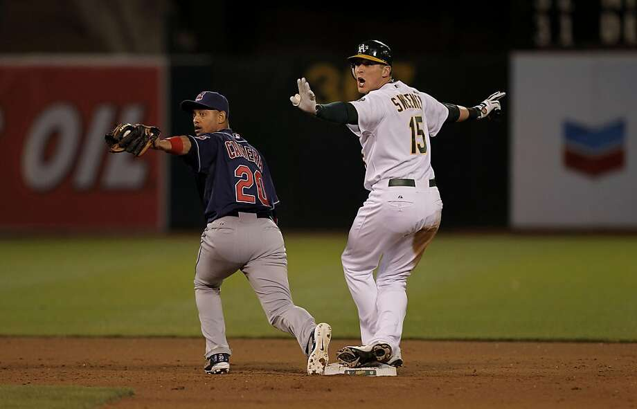 The Athletics' Ryan Sweeney looks for a safe call but is forced out by the Indians' Orlando Cabrera in the seventh inning in Oakland on Tuesday. Photo: Michael Macor, The Chronicle
