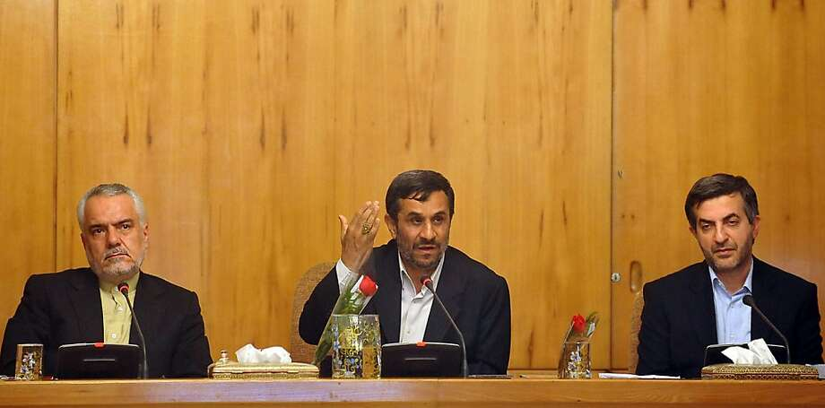 Iranian President Mahmoud Ahmadinejad (C) addresses a cabinet meeting while sitting between presidential adviser Esfandyar Rahim Mashaie (R) and first vice president Mohammad Reza Rahimi (L) in Tehran on May 1, 2011 as he ended a nine-day boycott of official activities. Photo: Sajad Safari, AFP/Getty Images