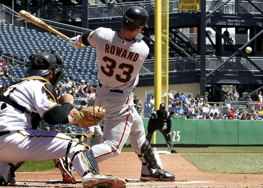 San Francisco Giants' Aaron Rowand (33) hits a two-run double off Pittsburgh Pirates pitcher Jeff Karstens in the third inning of a baseball game  in Pittsburgh Thursday, April 28, 2011. Catching is Pirates' Ryan Doumit. The Giants won 5-2. Photo: Gene J. Puskar, AP