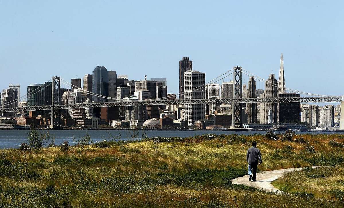 Jimmy Hsu of San Francisco, walks along the Middle Harbor Shoreline Park, in Oakland, Calif. on Tuesday April 26, 2011, against the skyline of San Francisco. The American Lung Association has given San Francisco City and County an
