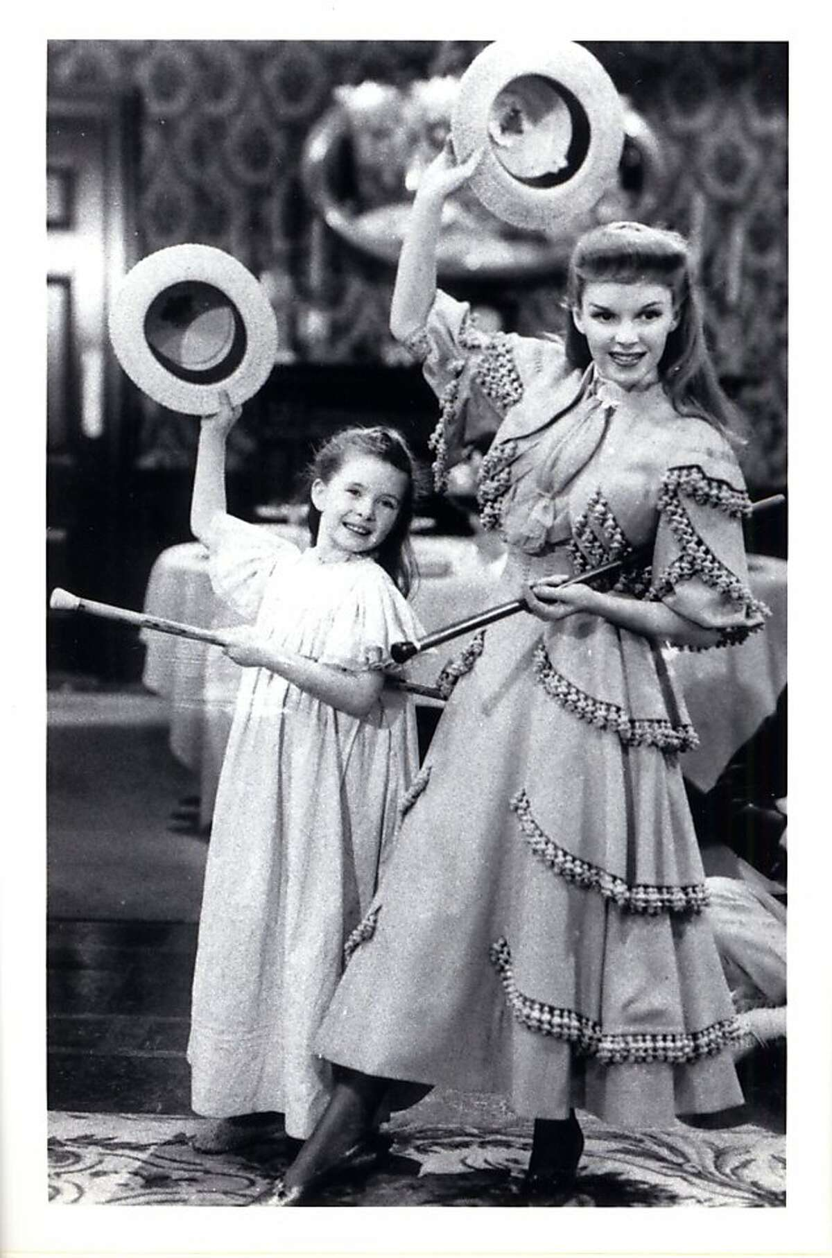Margaret O'Brien and Judy Garland in
