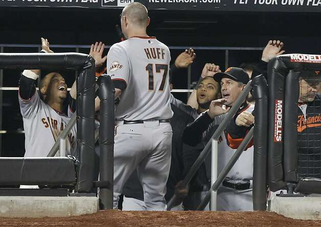 San Francisco Giants' Aubrey Huff (17) is greeted by teammates after hitting a home run during the tenth inning of a baseball game against the New York Mets Tuesday, May 3, 2011, at CitiField in New York. Photo: Frank Franklin II, AP