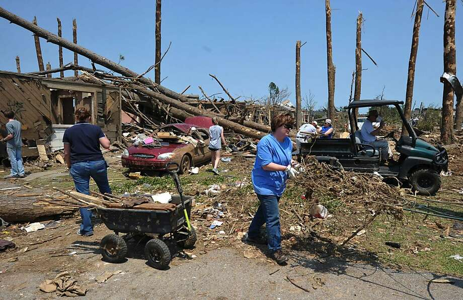 Residents and volunteers clear debris in the tornado stricken Forest Lake neighbourhood April 30, 2011 in Tuscalosa, Alabama. Residents are reeling from the worst US tornadoes in nearly 80 years. Photo: Mandel Ngan, AFP/Getty Images