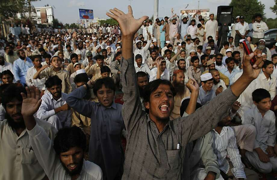 People chant slogans to condemn the killing of Osama bin Laden, as they gather to offer funeral prayers in Karachi, Pakistan, on Tuesday, May 3, 2011.   People gathered to demonstrate their feelings, and offer funeral prayers a day after the death of al-Qaida leader Osama bin Laden in a U.S. led attack on a safe-house compound in Abbottabad, Pakistan. Photo: Shakil Adil, AP