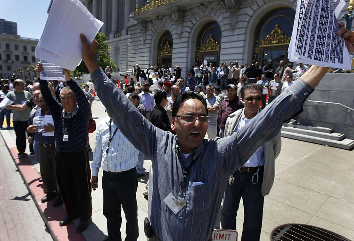 Taxi driver Tarlochan Singh joins other cabbies in front of City Hall to protest against a five percent surcharge for customers paying by credit cards in San Francisco, Calif. on Tuesday, May 3, 2011.