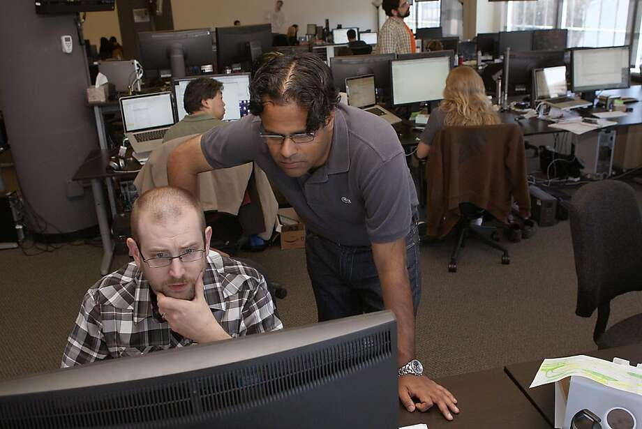 Ayan Mandal (middle) talking with an engineer at Lookout Mobile Security, which relocated to a bigger space last November and is recently searching for an even bigger space in San Francisco, Calif., on Monday,  May 2, 2011.  Lookout Mobile Security is a mobile security and antivirus software for smartphone protection, Photo: Liz Hafalia, The Chronicle
