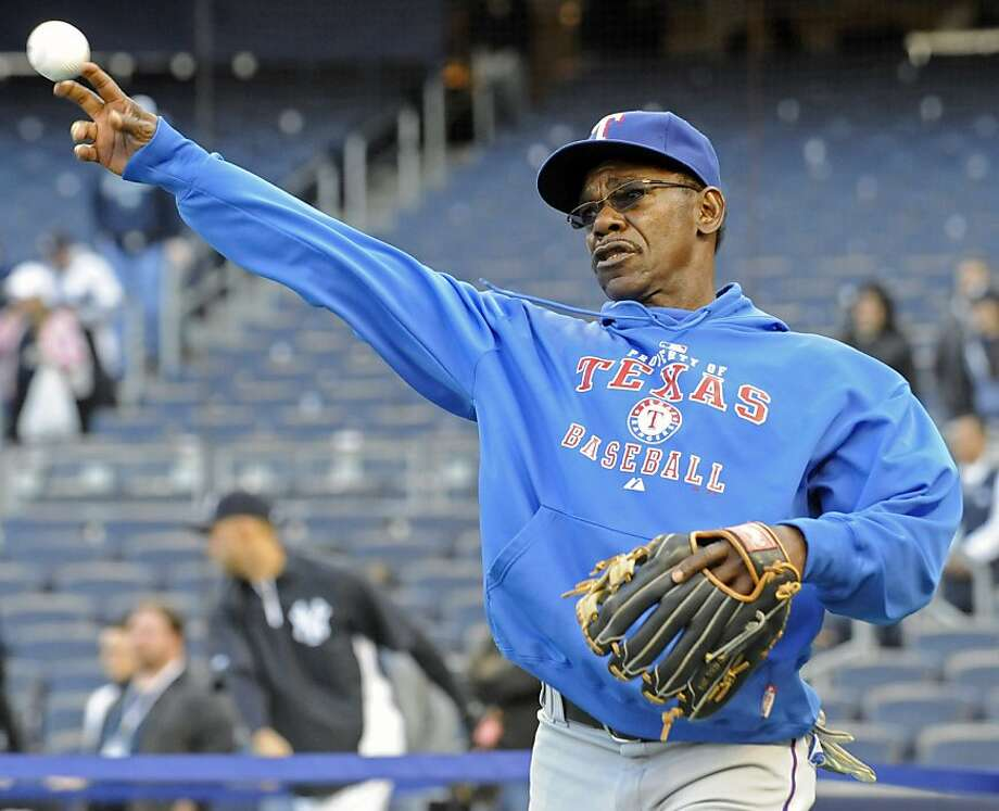 Texas Rangers manager Ron Washington loosens up before their baseball game against the New York Yankees Sunday, April 17, 2011 at Yankee Stadium in New York. Photo: Bill Kostroun, AP
