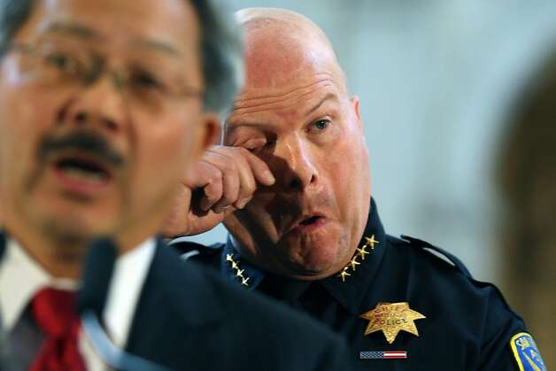 San Francisco Mayor Ed Lee left, closes Greg Suhr swearing-in ceremony as Suhr wipes a tear from his eye. Suhr was appointed chief of police for SFPD at San Francisco City Hall Wednesday, April 27, 2011. Photo: Lance Iversen, The Chronicle