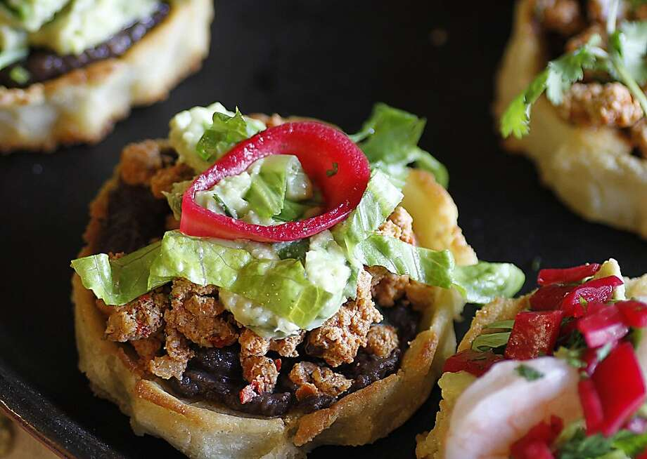 Sopes topped with black bean puree, chipotle chorizo and beet red onions, for Cinco de Mayo. Photo: Robert McMahan