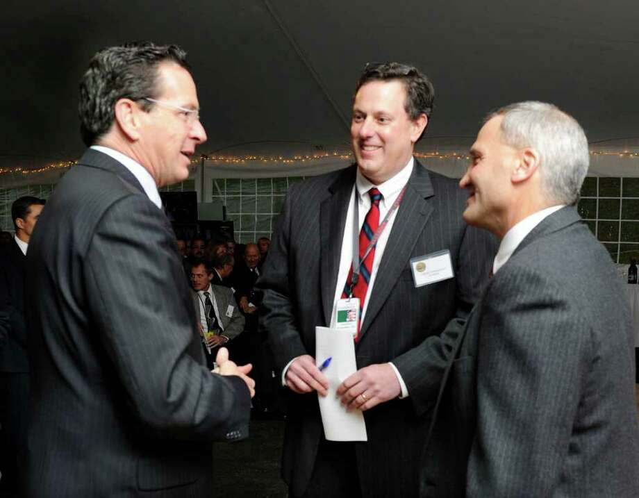 Gov. Dannel P. Malloy, left, speaks with Andreas Nonnenmacher, center, vice president and general manager at Goodrich IRS Systems, and David Imbrogno, director of threat detection systems, before a program at Goodrich Wednesday. Photo taken Tuesday, Dec. 7, 2011. Photo: Carol Kaliff / The News-Times