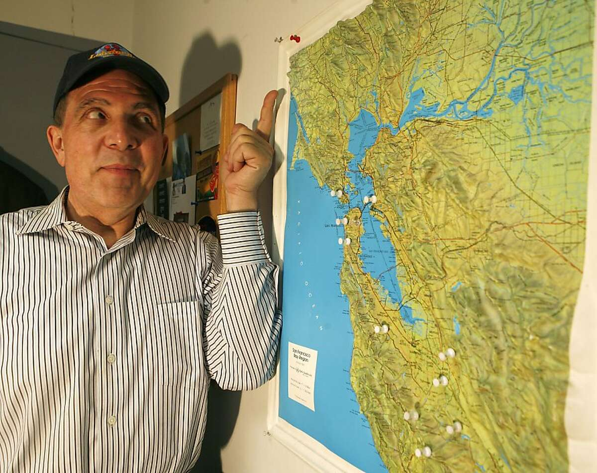 """Paul """"Lobster"""" Wells, a rock DJ from 80s and 90s radio, points to the location of the transmitter for the radio show he now does in the weekend in Sonoma County. The white pins are locations of transmitters for radio stations he previously broadcasted from."""