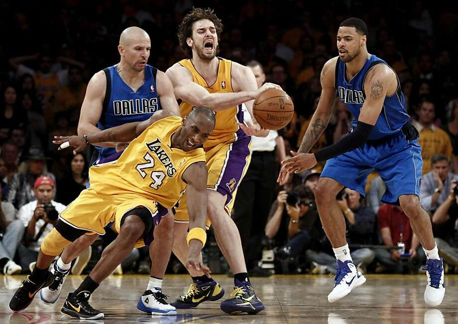 Los Angeles Lakers' Kobe Bryant (24) and Pau Gasol turn the ball over while defended by Dallas Mavericks' Jason Kidd, left, and Tyson Chandler during the second half in Game 1 of a second-round NBA playoff basketball series Monday, May 2, 2011, in Los Angeles.  The Mavericks won 96-94. Photo: Matt Sayles, AP