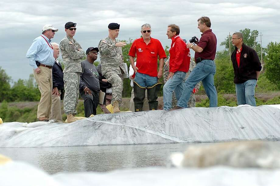 Major Gen. Michael Walsh gestures while being briefed by US Army Corps of Engineers personnel during a stop in Cairo, Ill., Saturday, April 30, 2011. Walsh said that the levee system has not been under the pressure that is currently on the system since being built in 1928. Photo: Stephen Lance Dennee, AP
