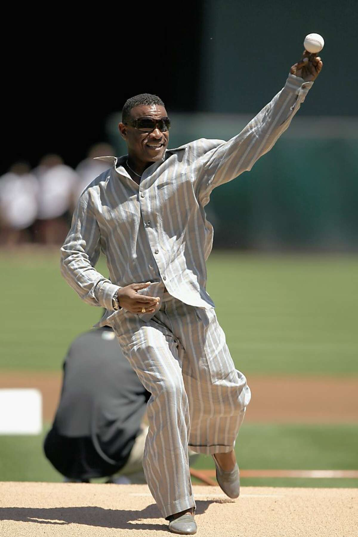 OAKLAND, CA - APRIL 30: Rickey Henderson throws out the ceremonial first pitch before the Oakland Athletics' game against the Texas Rangers at Oakland-Alameda County Coliseum on April 30, 2011 in Oakland, California.
