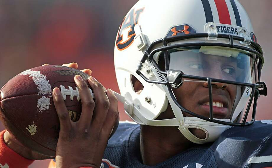 FILE - In this Nov. 13, 2010, file photo, Auburn quarterback Cam Newton warms up prior to an NCAA college football game against Georgia at Jordan-Hare Stadium in Auburn, Ala.  Newton is a top prospect in the upcoming NFL Draft. Photo: Dave Martin, AP